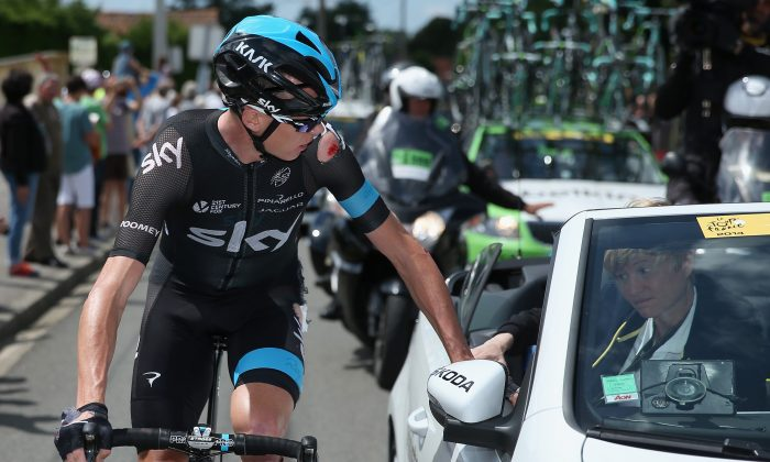 Chris Froome of Team Sky receives medical attention after being crashing early in Stage Four of the 2014 Le Tour de France on July 8, 2014 in Le Touquet-Paris-Plage, France. (Doug Pensinger/Getty Images)