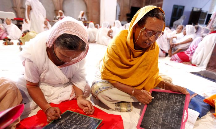 Widows lean to read and write in Vrindavan, India on July 29 2014. Sulabh International, an NGO has started an welfare initiative for widows in Varanasi, Vrindavan and Sarnath, India. (Courtesy of Sulabh International)