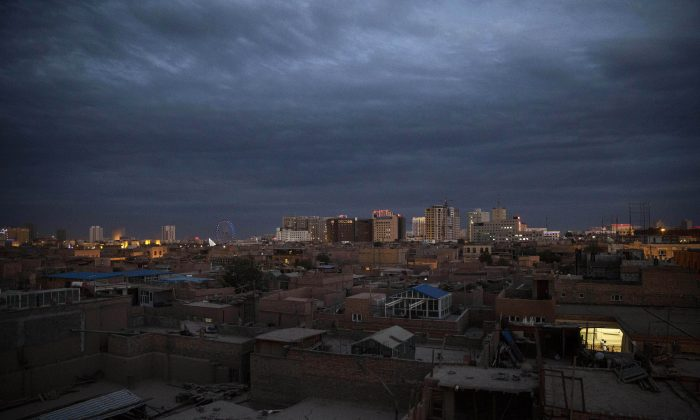 A view of Kashgar City, Xinjiang, China, on July 31, 2014. A criticism session was held in Kashgar on Monday, where 15 officials were reprimanded and 8 removed from their posts for having religious beliefs or engaging in religious activities. (Kevin Frayer/Getty Images)