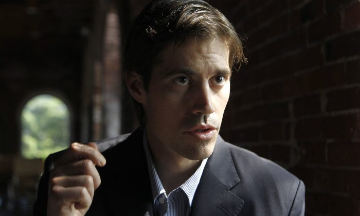 Journalist James Foley, of Rochester, N.H., responds to questions during an interview with The Associated Press, in Boston, Friday, May 27, 2011. Foley, who was working for the Boston-based GlobalPost while reporting in Libya, was captured along with two others by Libyan government forces on April 5, 2011, while reporting on the Libyan conflict. (AP Photo/Steven Senne)