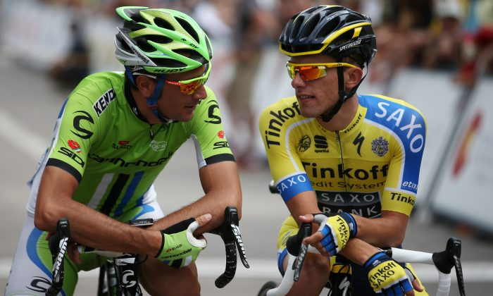Ivan Basso of Cannondale chats with future teammate Rafal Majka of Tinkoff-Saxo during Stage One of the 2014 USA Pro Challenge on August 18, 2014 in Aspen, Colorado. (Chris Graythen/Getty Images)