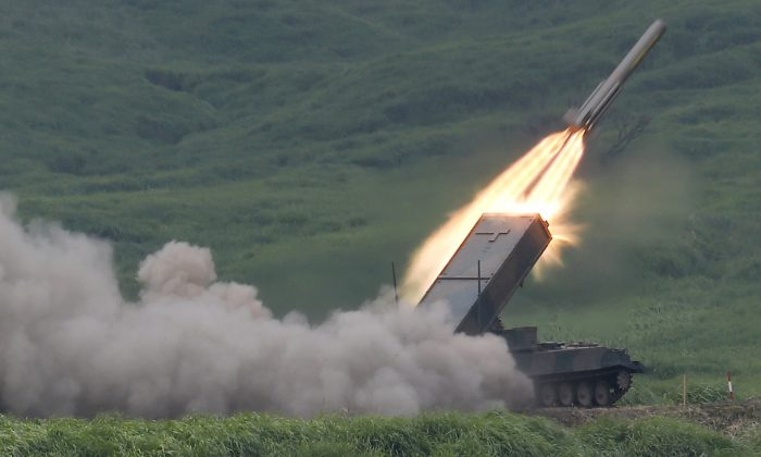 The Japan Ground Self-Defense Force's anti-landmine missile is launched during an annual live firing exercise at Higashi Fuji range in Gotemba, southwest of Tokyo, on Aug. 19, 2014. (AP Photo/Shizuo Kambayashi)