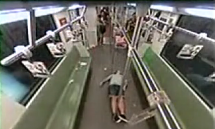Surveillance video shows a passenger, a Westerner, lying on the floor on the Shanghai Metro in Shanghai, China, on Aug. 9. Passengers in the cart fled the scene after seeing him faint. (Screenshot/Sohu.com)