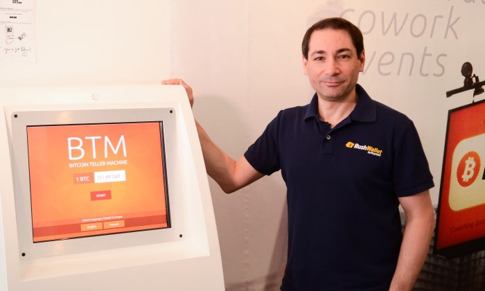 Anthony Di lorio, a Bitcoin evangelist, stands beside a BTM that sells his own personal Bitcoins at his downtown Toronto business centre. Di lorio says recent thefts of Bitcoin are the fault of poorly secured third parties. (Chrisy Trudeau/Epoch Times)