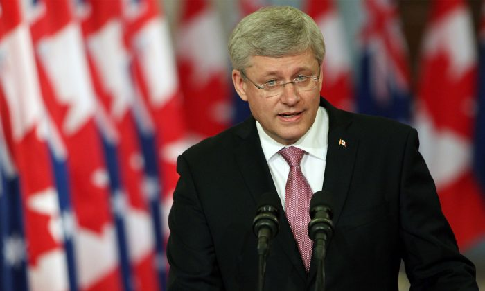 Canadian Prime Minister Stephen Harper addresses media alongside Australian Prime Minister Tony Abbott (not pictured) during a joint press conference in Parliament Hill in Ottawa, Canada on June 9, 2014. (Cole Burston/AFP/Getty Images)