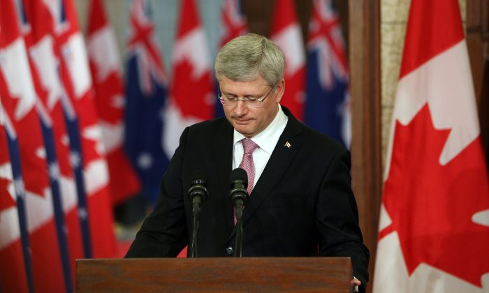 Canadian Prime Minister Stephen Harper pauses as he address the media alongside Australian Prime Minister Tony Abbott (not shown) on Parliament Hill in Ottawa, Canda, June 9, 2014. (Cole Burston/AFP/Getty Images)