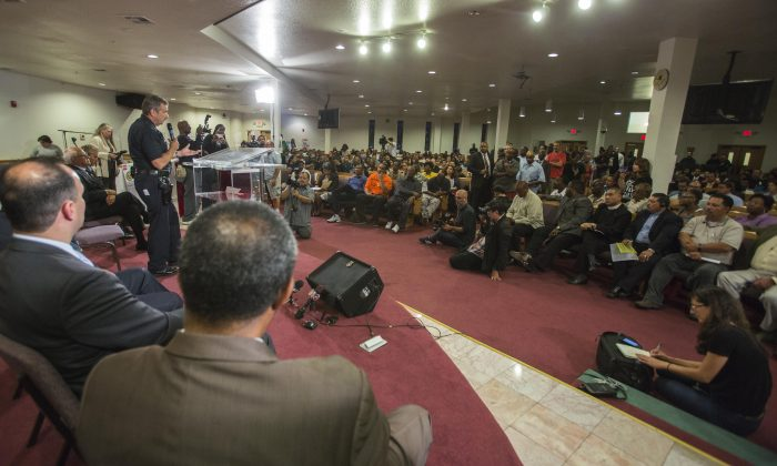 Los Angeles Police Chief Charlie Beck takes questions during a community forum on Aug. 19 in Los Angeles to discuss the police shooting of 25-year-old Ezell Ford. (AP Photo/Ringo H.W. Chiu)