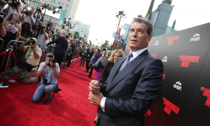Pierce Brosnan seen at The World Premiere of 'November Man' on Wednesday, Aug. 13, 2014 at the TCL Chinese Theatre in Los Angeles. (Photo by Eric Charbonneau/Invision for Relativity Studios/AP Images)