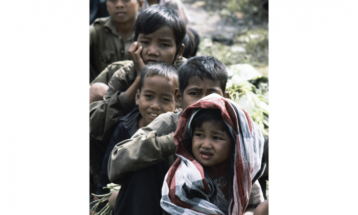 Cambodian refugees wait to receive food at a temporary refugee camp near the Thai-Cambodian border in November 1979. In 2014, some adult Cambodian refugees in the United States are being deported to Cambodia. (AP Photo/Jeff Robbins)