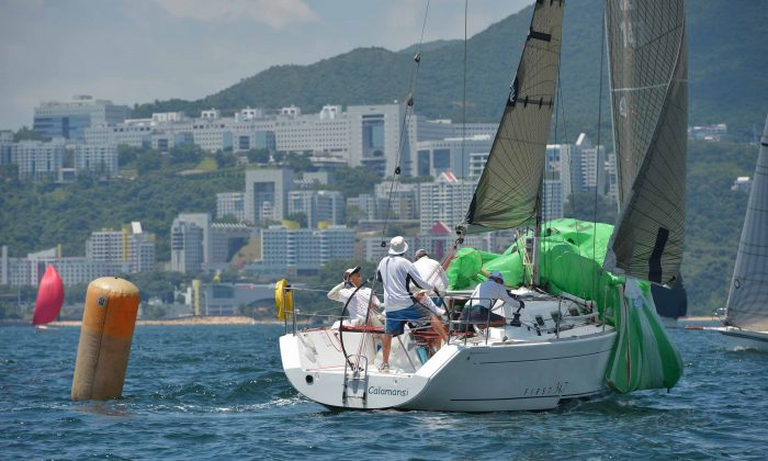 'Calamansi' Line Honours winner and winner on handicap of re-sail Race-2 of the Quest Yachting typhoon Series at Port Shelter on Sunday Aug 17, 2014. Calamansi also took Line Honours in the Islands race that followed. (Bill Cox/Epoch Times)