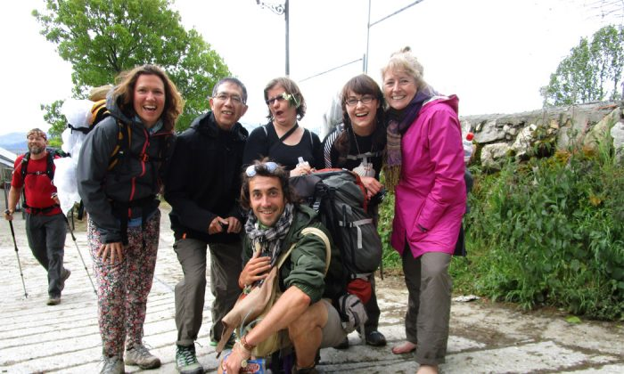 """Sue Kenney (R) poses with a group of walkers on the Camino de Santiago, a medieval pilgrimage route in Spain. A proponent of the barefoot or """"earthing"""" movement, Kenney leads regular guided tours along the Camino while barefoot. (Courtesy Sue Kenney)"""