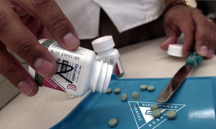 The prescription medicine OxyContin at a Walgreens drugstore in Brookline, MA., on Aug. 21, 2001. The powerful painkiller, manufactured to relieve the pain of seriously ill people, is being used by some addicts to achieve a high similar to a heroin rush. Its popularity among abusers of the drug has resulted in a string of pharmacy robberies nationwide. Armed robbers raid the pharmacies for the painkiller which has a street value of $40 for a 40mg pill. (Darren McCollester/Getty Images)