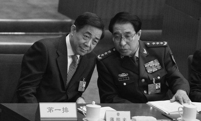 General Xu Caihou, then-Vice Chairman of the Communist Party of China's Central Military Commission, talks with China's Chongqing Municipality Communist Party Secretary Bo Xilai during the opening ceremony of the National People's Congress at the Great Hall of the People on March 5, 2012 in Beijing, China. Xu and Bo conspired to establish forced organ harvesting in Liaoning Province. (Feng Li/Getty Images)