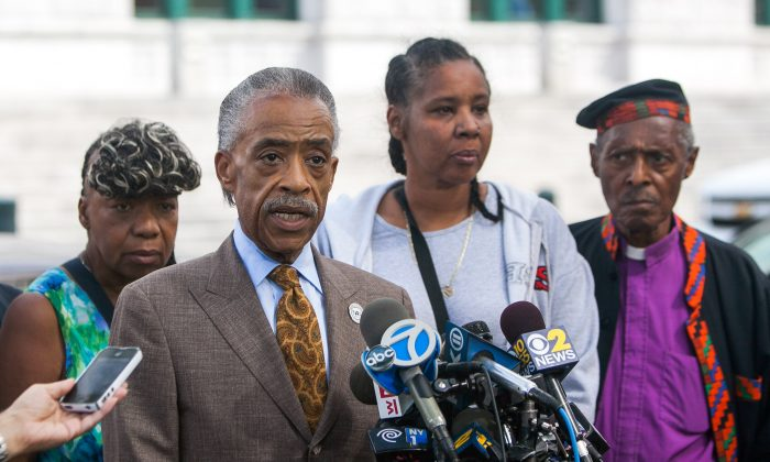 Rev. Al Sharpton speaks at a press conference in Brooklyn, Aug. 21, 2014, with Esaw Garner (2nd R), wife of Eric Garner killed during a police arrest. (Petr Svab/Epoch Times)