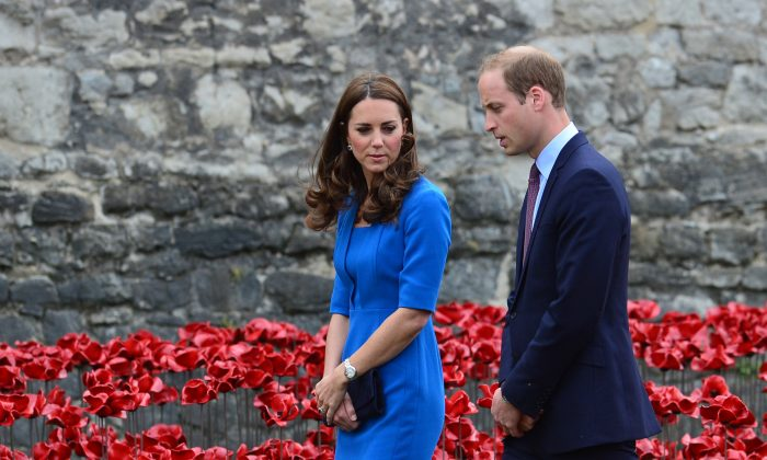 Britain's Prince William (R) and his wife Catherine, Duchess of Cambridge, visit the Tower of London's 'Blood Swept Lands and Seas of Red' poppy installation, in central London, on August 5, 2014. (Carl Court/AFP/Getty Images)