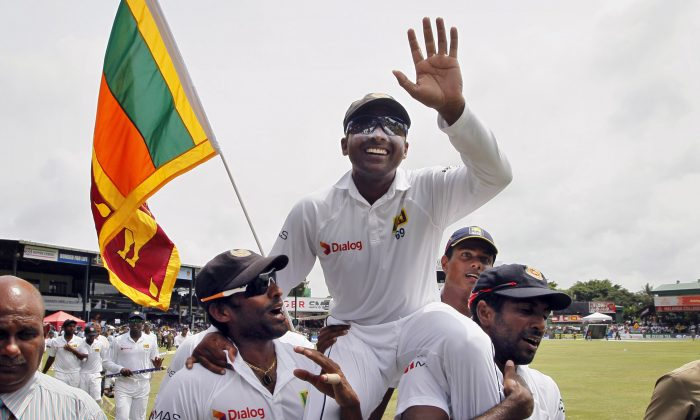 Sri Lanka''s Mahela Jayawardene, center, is carried by teammates Chanaka Welegedara, left, and Dhammika Prasad as they celebrate winning their second cricket test match against Pakistan by 105 runs, in Colombo, Sri Lanka, Monday, Aug. 18, 2014. Sri Lanka won the series 2-0. (AP Photo/Eranga Jayawardena)