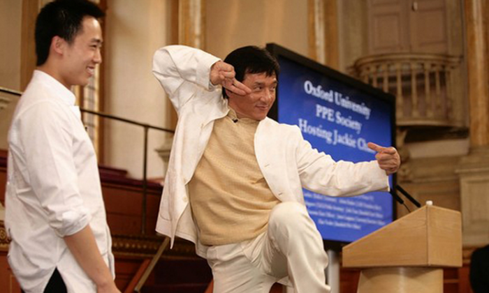 Jackie Chan strikes a Kung Fu pose on stage with Bo Guagua, son of disgraced former communist official Bo Xilai, at Oxford University in 2008. (Screenshot/takungpao.com)