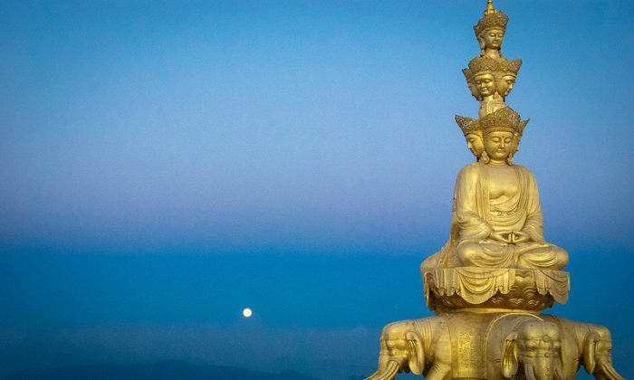 The setting moon behind Buddha and the rising sun (Kristin Addis, Be My Travel Muse)
