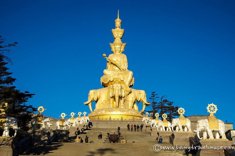 Golden Buddha with faces pointed in every direction (Kristin Addis, Be My Travel Muse)