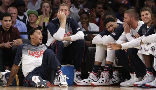 The NBA rumors and news keep flying, particularly about potential trades and the Team USA. U.S. guard Derrick Rose, left, sits on the floor, next to forward Mason Plumlee and other teammates sitting on the bench during the second half of an exhibition basketball game at Madison Square Garden in New York, Wednesday, Aug. 20, 2014. Rose didn't play as the United States defeated the Dominican Republic 105-62. (AP Photo/Kathy Willens)