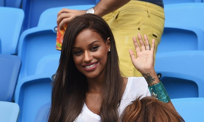 Mario Balotelli's girlfriend Fanny Neguesha waves ahead of the 2014 FIFA World Cup Brazil Group D match between Italy and Uruguay at Estadio das Dunas on June 24, 2014 in Natal, Brazil. (Photo by Claudio Villa/Getty Images)
