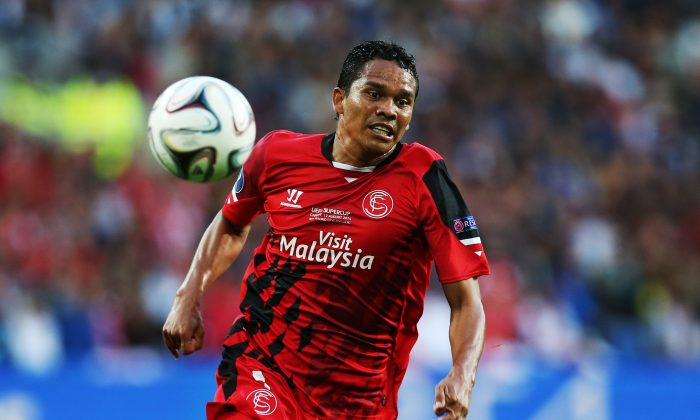 Carlos Bacca of Sevilla controls the ball during the UEFA Super Cup match between Real Madrid and Sevilla at Cardiff City Stadium on August 12, 2014 Cardiff, Wales. (Photo by Ian MacNicol/Getty Images)