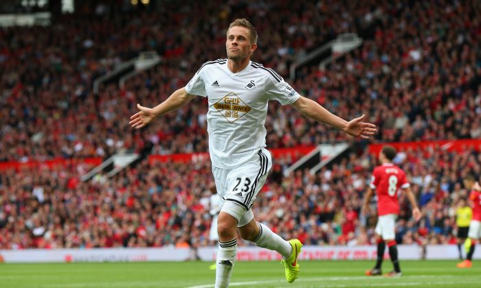 Gylfi Sigurdsson of Swansea City celebrates scoring his team's second goal during the Barclays Premier League match between Manchester United and Swansea City at Old Trafford on August 16, 2014 in Manchester, England. (Photo by Alex Livesey/Getty Images)