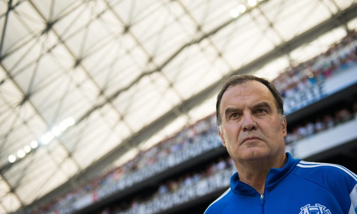 Marseille's Argentinian head coach Marcelo Bielsa stands prior to the French L1 football match Olympique de Marseille vs Montpellier on August 17, 2014 at the Velodrome stadium in Marseille, southern France. (BERTRAND LANGLOIS/AFP/Getty Images)