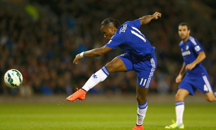 Didier Drogba of Chelsea shoots at goal during the Barclays Premier League match between Burnley and Chelsea at Turf Moor on August 18, 2014 in Burnley, England. (Photo by Clive Brunskill/Getty Images)