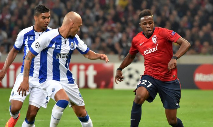 Porto's Brazilian defender Maicon (C) challenges Lille's French forward Divock Origi during the UEFA Champions League play-off first leg football match between Lille and Porto at the Pierre Mauroy Stadium in Villeneuve d'Ascq, northern France, on August 20, 2014. (PHILIPPE HUGUEN/AFP/Getty Images)