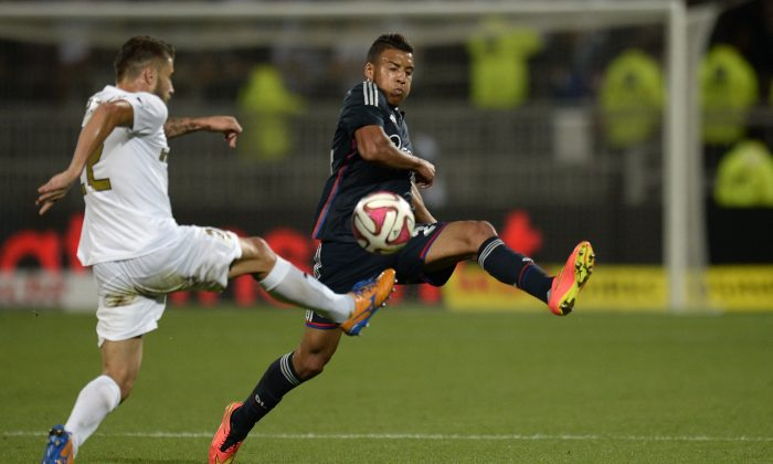 Lyon's French midfielder Corentin Tolisso (R) vies for the ball with Giurgiu's Greek defender Vasileios Pliatsikas during the UEFA Europa League football match between Olympique Lyonnais (OL) and Astra Giurgiu (AFCA) on August 21, 2014 at the Gerland Stadium in Lyon, central-eastern France. (ROMAIN LAFABREGUE/AFP/Getty Images)