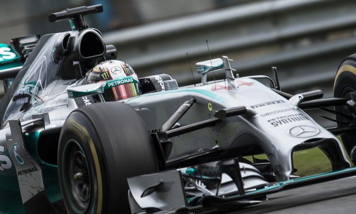 British Lewis Hamilton of Mercedes AMG Petronas F1 Team drives during the second practice session at the Spa-Francorchamps circuit in Spa on August 22, 2014 ahead of the Belgium Formula One Grand Prix. (NICOLAS LAMBERT/AFP/Getty Images)