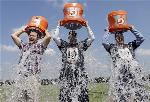 Participants challenge others on video to do it or donate money to ALS before dumping ice cold water over their heads. (AP Photo/David J. Phillip)