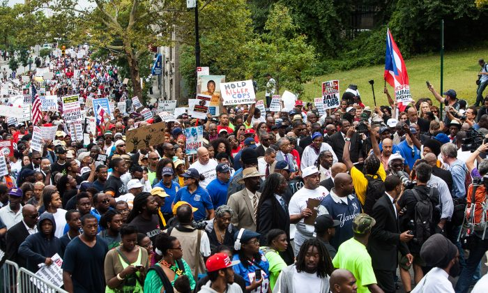 A march on Staten Island, Aug. 23, 2014, for Eric Garner, a man killed July 17 when a policeman put him in a chokehold, and against police brutality. (Petr Svab/Epoch Times)