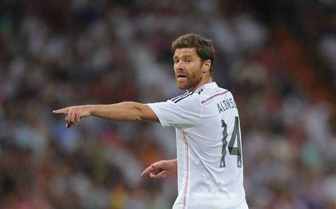 Xabi Alonso of Real Madrid reacts during the Supercopa first leg match between Real Madrid and Club Atletico de Madrid at Estadio Santiago Bernabeu on August 19, 2014 in Madrid, Spain. (Photo by Denis Doyle/Getty Images)