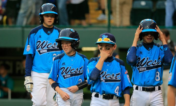 Members of the West Team from Las Vegas, Nevada walk off the field following their 7-5 loss to the Great Lakes Team from Chicago, Illinois during the United States Championship game of the Little League World Series at Lamade Stadium on August 23, 2014 in South Williamsport, Pennsylvania. (Photo by Rob Carr/Getty Images)
