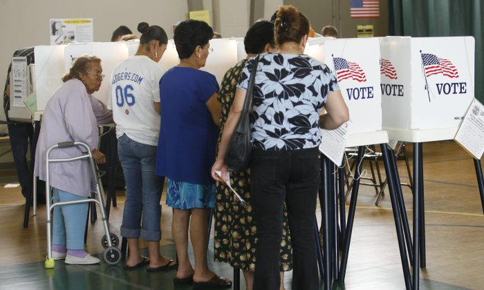 In this June 6, 2006 file photo, voters cast their ballots in the California primary election in Los Angeles. (AP Photo/Damian Dovarganes)