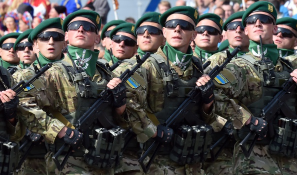 Ukrainian forces parade during a military ceremony marking the 23rd anniversary of Ukraine's independence in the center of Kiev on August 24, 2014. Ukraine's President Petro Poroshenko on August 24 decried Russian 'aggression' as Kiev staged a symbolic Independence Day parade while battling pro-Moscow rebels in the east of the country. (SERGEI SUPINSKY/AFP/Getty Images)