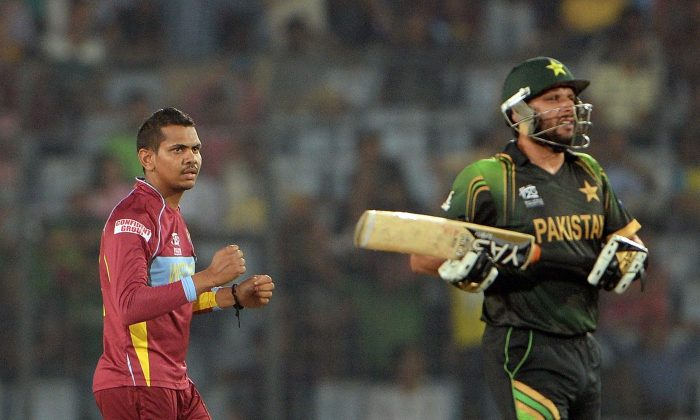 West Indies bowler Sunil Narine (L) celebrates after taking the wicket of Pakistan batsman Sohail Tanvir during the ICC World Twenty20 tournament cricket match between Pakistan and West Indies at The Sher-e-Bangla National Cricket Stadium in Dhaka on April 1, 2014. (PUNIT PARANJPE/AFP/Getty Images)