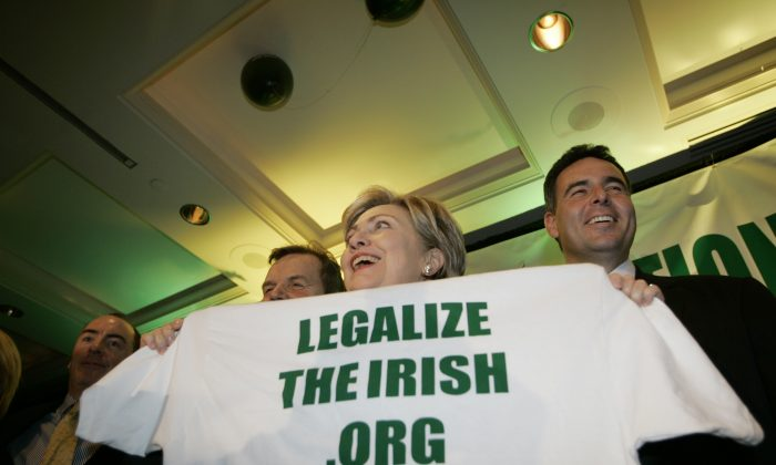 In this file photo, Grant Lally (R), then-president of the Irish Lobby of Immigration Reform, appears at an event with presidential hopeful Sen. Hillary Rodham Clinton (2nd R) in Washington, D.C., on March 7, 2007. (AP Photo/Gerald Herbert)