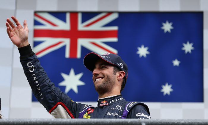 Daniel Ricciardo of Red Bull Racing celebrates on the podium after winning the Belgian Grand Prix at Circuit de Spa-Francorchamps on August 24, 2014 in Spa, Belgium. (Clive Mason/Getty Images)