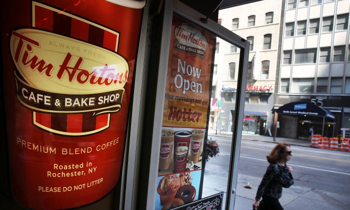 A person walks past a Tim Horton's cafe in Manhattan on Monday. (Spencer Platt/Getty Images)