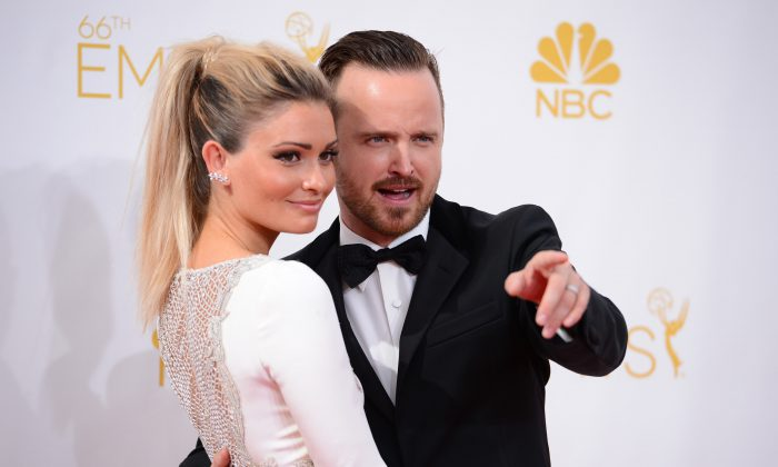 Lauren Parsekian, left, and Aaron Paul arrive at the 66th Annual Primetime Emmy Awards at the Nokia Theatre L.A. Live on Monday, Aug. 25, 2014, in Los Angeles. (Photo by Jordan Strauss/Invision/AP)