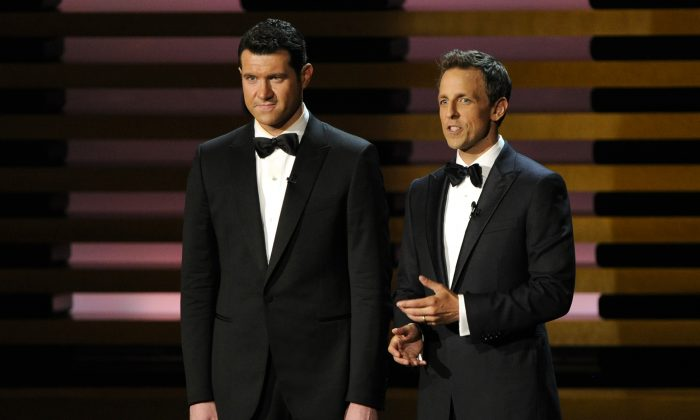 Billy Eichner, left, and Host Seth Meyers speak on stage at the 66th Annual Primetime Emmy Awards at the Nokia Theatre L.A. Live on Monday, Aug. 25, 2014, in Los Angeles. (Photo by Chris Pizzello/Invision/AP)