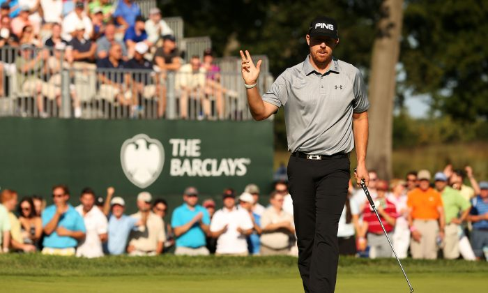 Hunter Mahan holds up his ball after putting for birdie on the 16th green during the final round of The Barclays at The Ridgewood Country Club on August 24, 2014 in Paramus, New Jersey. (Darren Carroll/Getty Images)