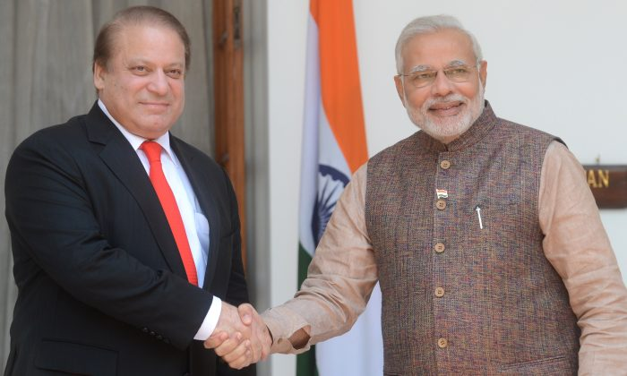 India's newly sworn-in Prime Minister Narendra Modi (R) shakes hands with Pakistani Prime Minister Nawaz Sharif during a meeting in New Delhi on May 27, 2014. (Raveendran/AFP/Getty Images)