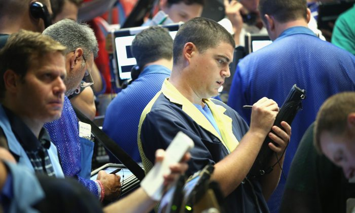 Traders take orders in the Standard & Poor's 500 stock index options pit at the Chicago Board Options Exchange (CBOE) in Chicago on July 30, 2014. (Scott Olson/Getty Images)