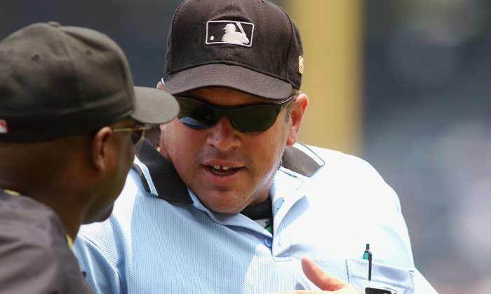 Umpire Wally Bell discusses a ground-rule double with Manager Lloyd McClendon of the Pittsburgh Pirates during the National Baseball League game between the Pittsburgh Pirates and the Atlanta Braves at Turner Field on July 22, 2004 in Atlanta, Georgia. (Scott Cunningham/Getty Images)
