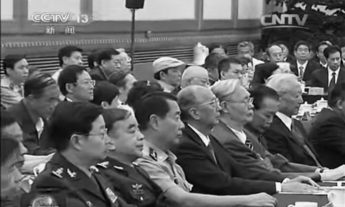 The sons and daughters of a previous generation of officials, including Liu Yuan, in short sleeves, attended the Party meeting on the 110th anniversary of Party patriarch Deng Xiaoping's birth on Aug. 20. But retired officials, including Hu Jintao and Jiang Zemin, were nowhere to be found. (Screenshot via CCTV)