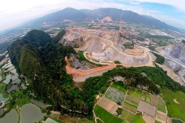 Aerial view of cement quarry and limestone hill home to a number of species found nowhere else including a new snail. Photo by: Ong Poh Teck/Basteria.